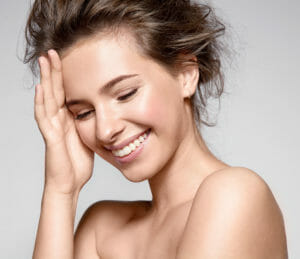 young smiling woman laughing
