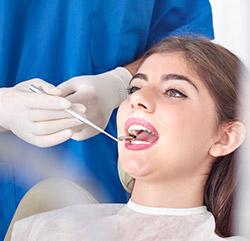 Woman receiving a dental checkup