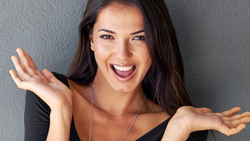 Woman showing off flawless smile
